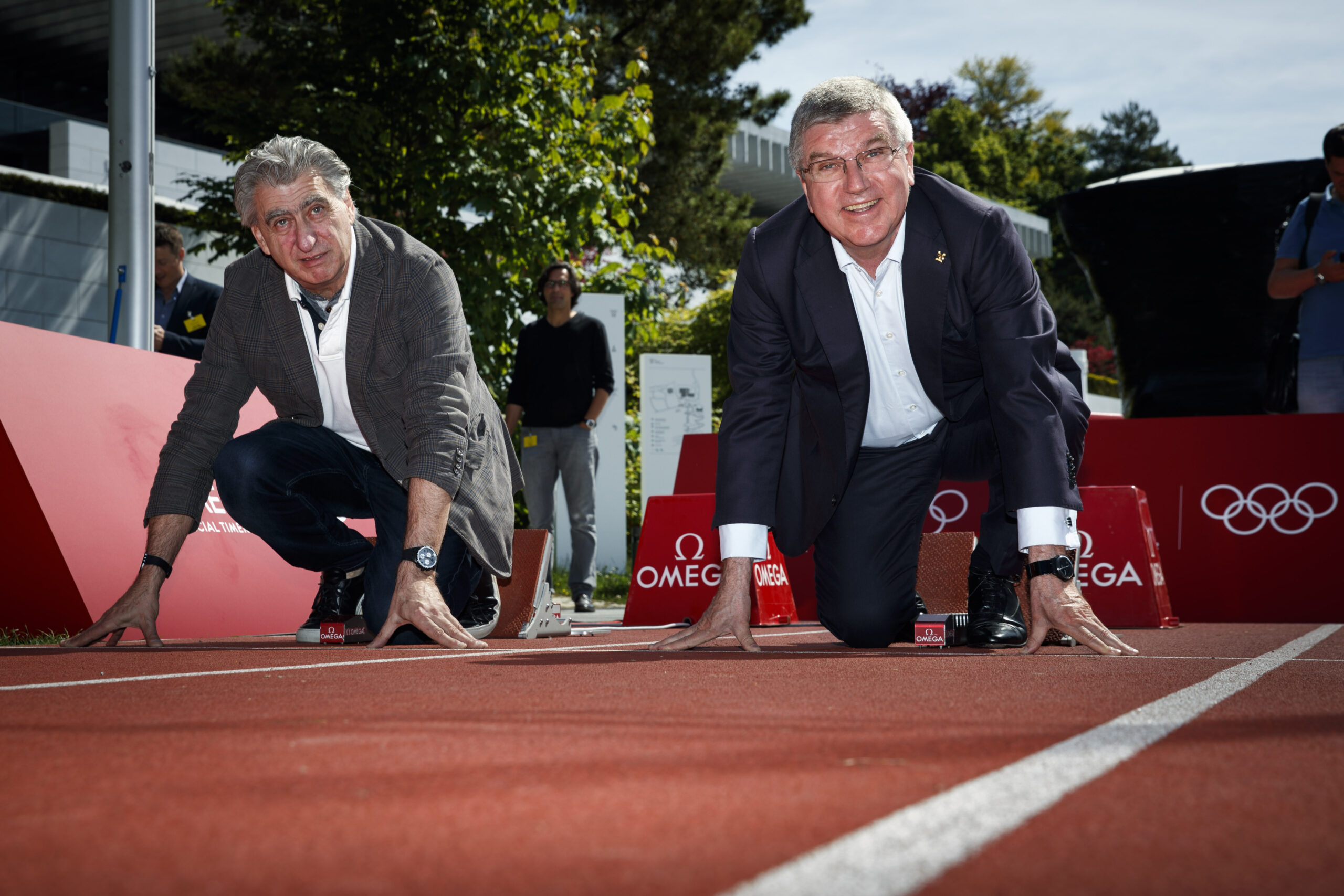 Nick Hayek, CEO of Swatch Group and IOC President Thomas Bach. Ready? 3-2-1-Go!