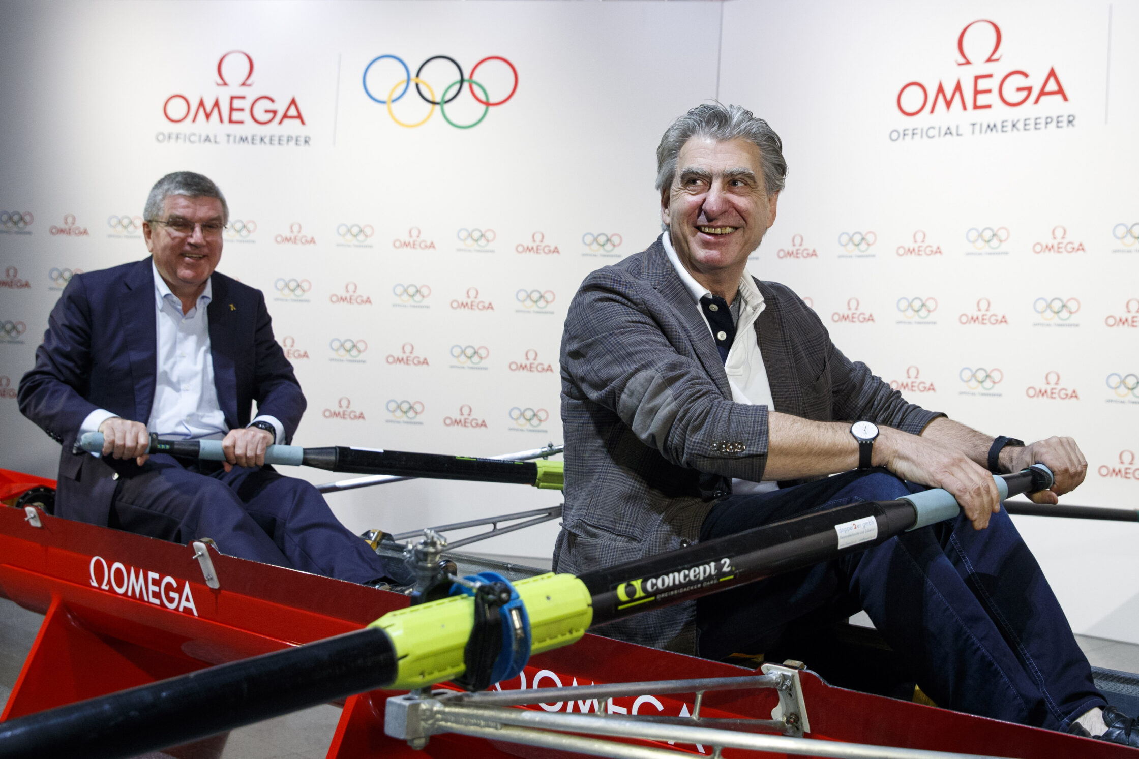 IOC President Thomas Bach and Nick Hayek, CEO of Swatch Group showing their strength at The Olympic Museum in Lausanne