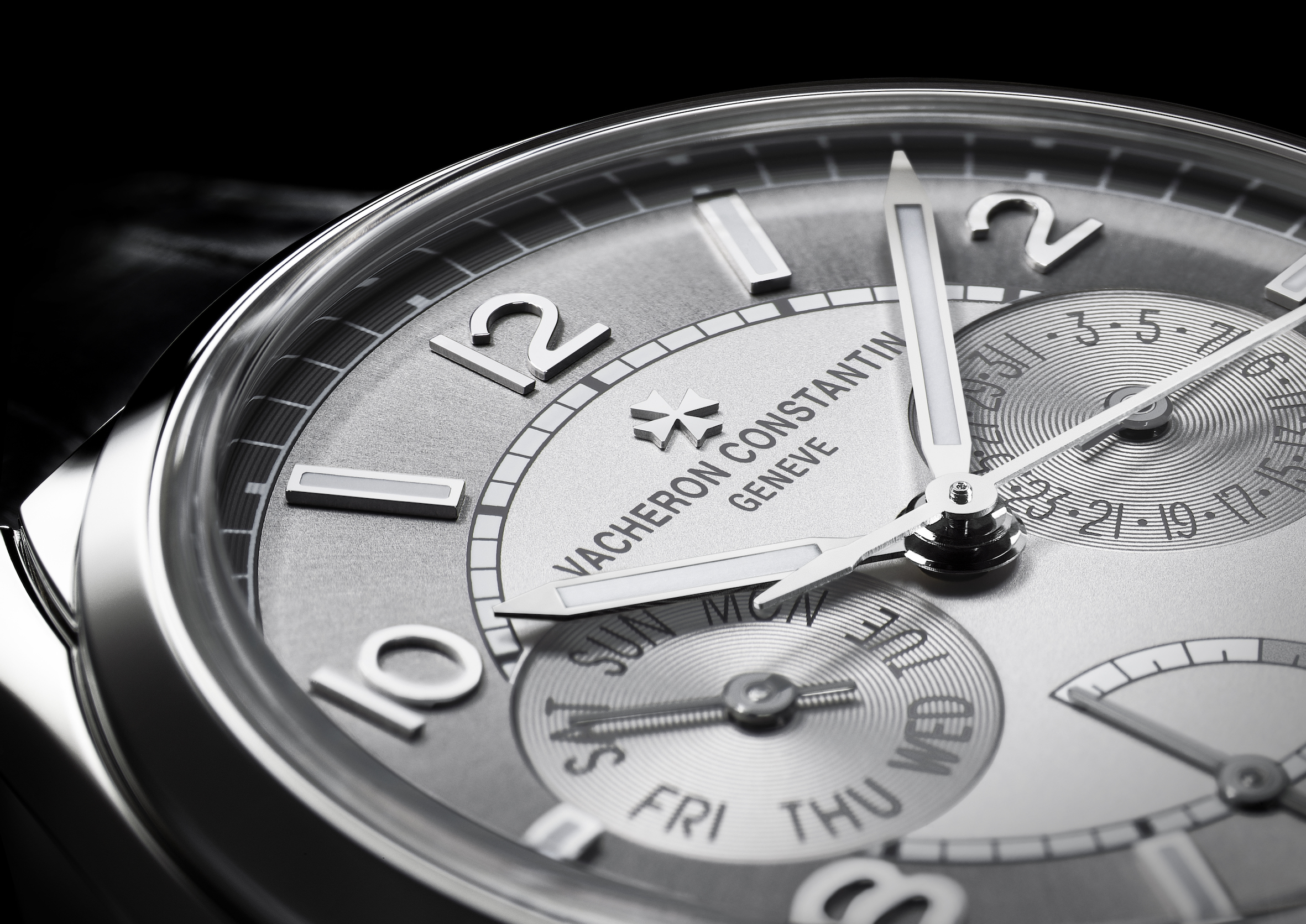 Vacheron Constantin FIFTYSIX day-date with power-reserve indicator. Monochrome dial with double opaline-sunburst effect, enhanced by the additional contrast of its two snailed counters.